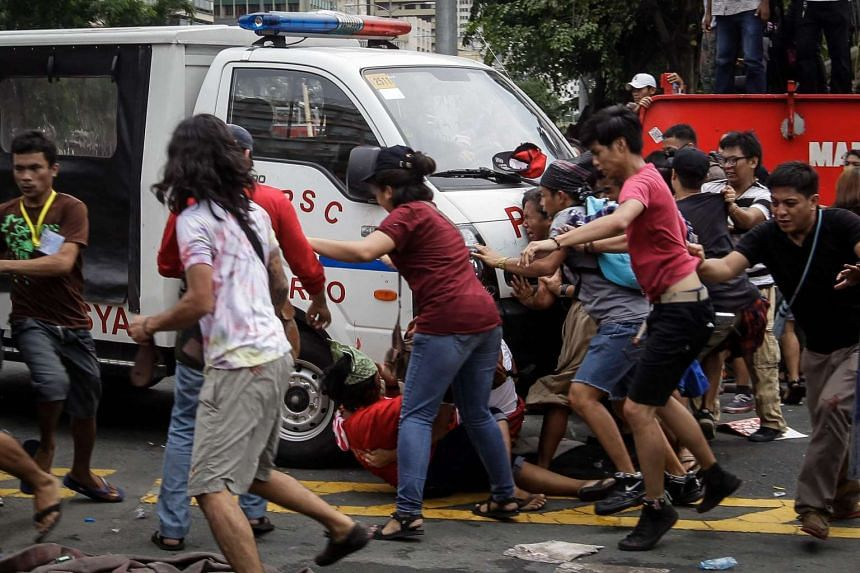A police van runs over protesters during a demonstration in front of the US Embassy in Manila, on Oct 19, 2016.