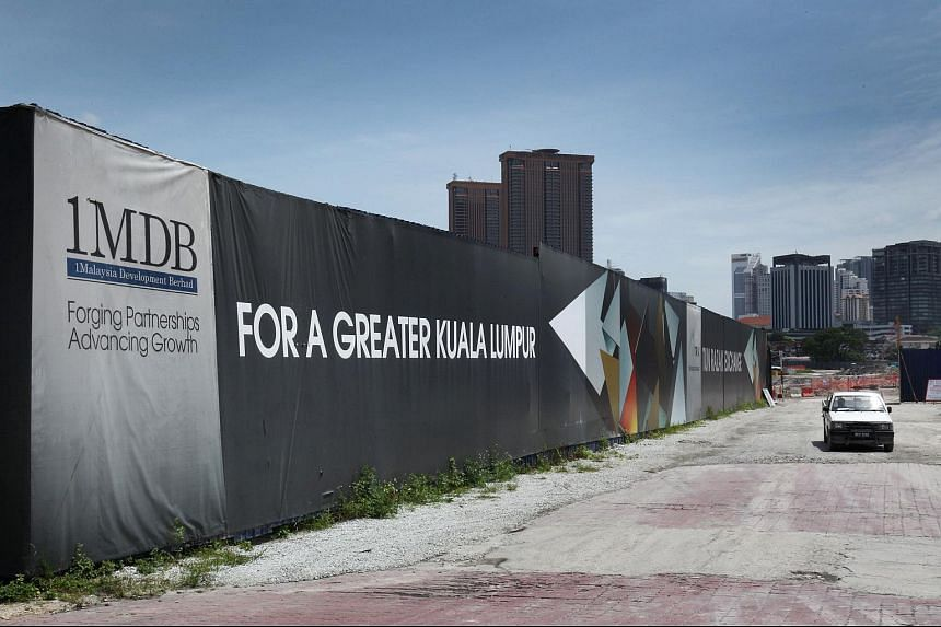 The signage for 1MDB is displayed at the site of the Tun Razak Exchange financial district in Kuala Lumpur.