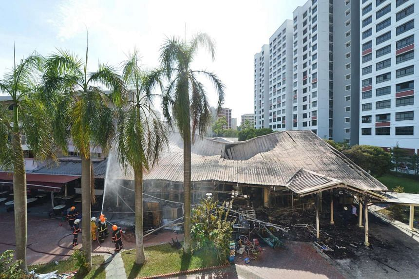 The charred remains of the coffee shop and wet market at Block 493, Jurong West Street 41, after it was engulfed by flames on Oct 11, 2016.