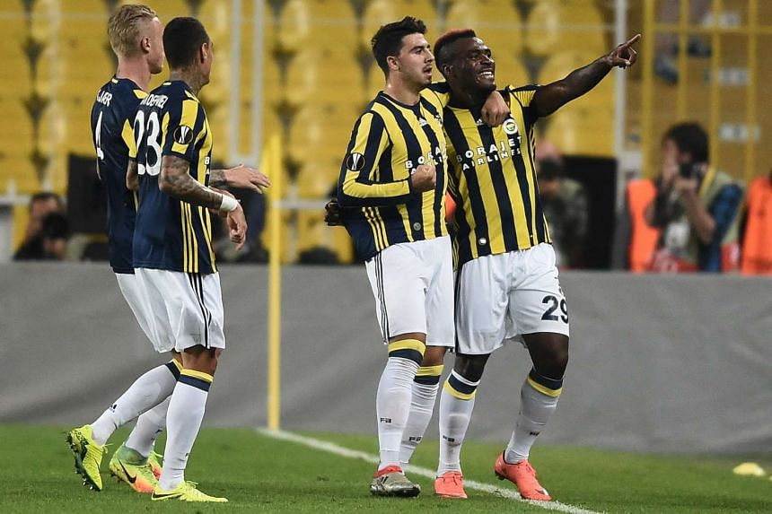 Fenerbahce players celebrate a goal during their UEFA Europa League football match against Feyenoord in Istanbul on Sept 29, 2016.