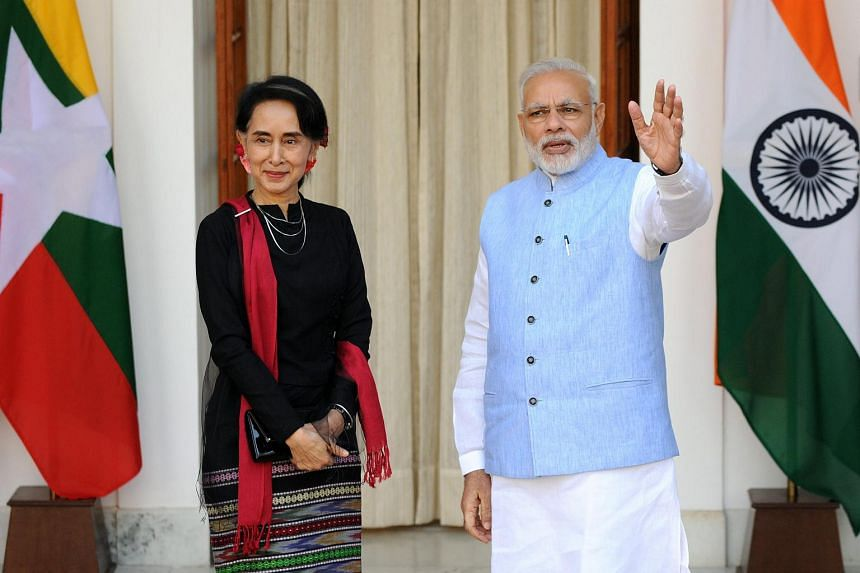 Myanmar's State Counsellor Aung San Suu Kyi (left) is welcomed by Indian Prime Minister Narendra Modi, ahead of their meeting in New Delhi on Oct 19, 2016.