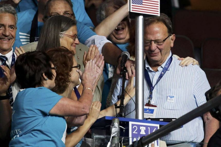 Larry Sanders casts a vote for his younger brother Senator Bernie Sanders during the Democratic National Convention in Philadelphia, Pennsylvania, US July 26, 2016.
