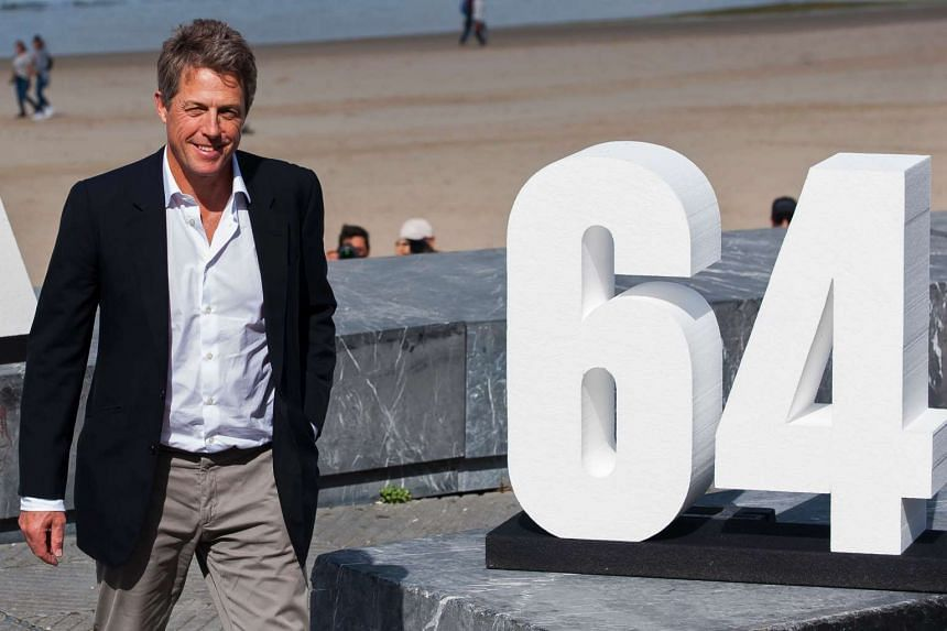 """British actor Hugh Grant poses for a photocall after the screening of his film """"Florence Foster Jenkins"""" during the 64th San Sebastian Film Festival, in the city of San Sebastian on Sept 18, 2016."""