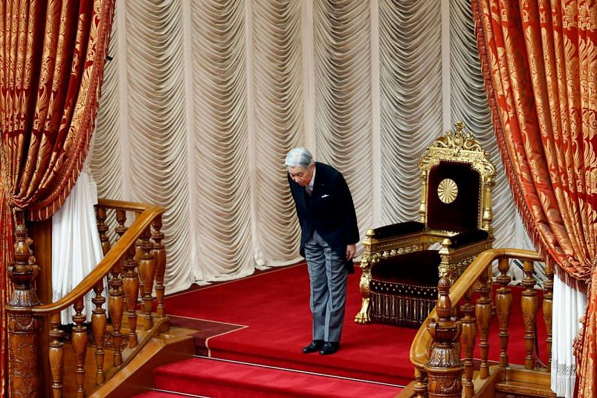 Japan's Emperor Akihito bows during a parliament session at the Upper House after declaring the start of the new parliament session in Tokyo on Sept 26, 2016.