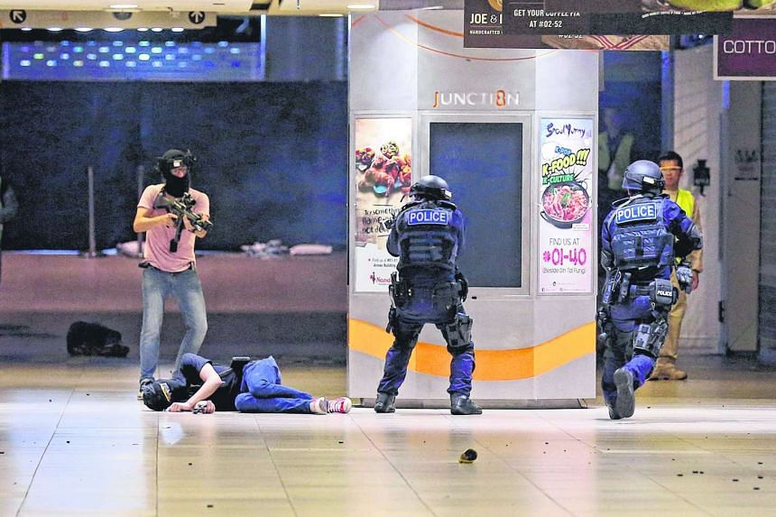 SPF's Emergency Response Teams in a gunfight with simulated terrorists at Junction 8, in the Phase 2 of the Islandwide Multi-agency Counter-Terrorism Exercise on Oct 18, 2016.