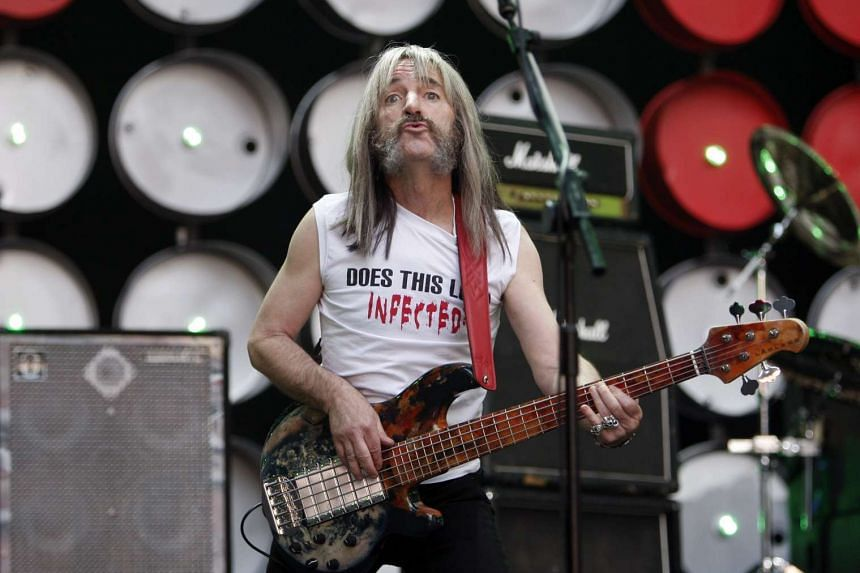 Derek Smalls (played by Harry Shearer) of Spinal Tap performs during the Live Earth concert at Wembley Stadium in London.