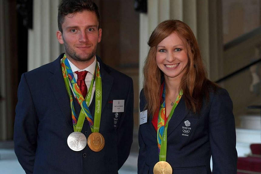 British Olympic athletes Joanna Rowsell (R) and Callum Skinner arrive at a reception for Team GB's Olympic and Paralympic teams hosted by Britain's Queen Elizabeth at Buckingham Palace in London, Britain, on Oct 18, 2016.