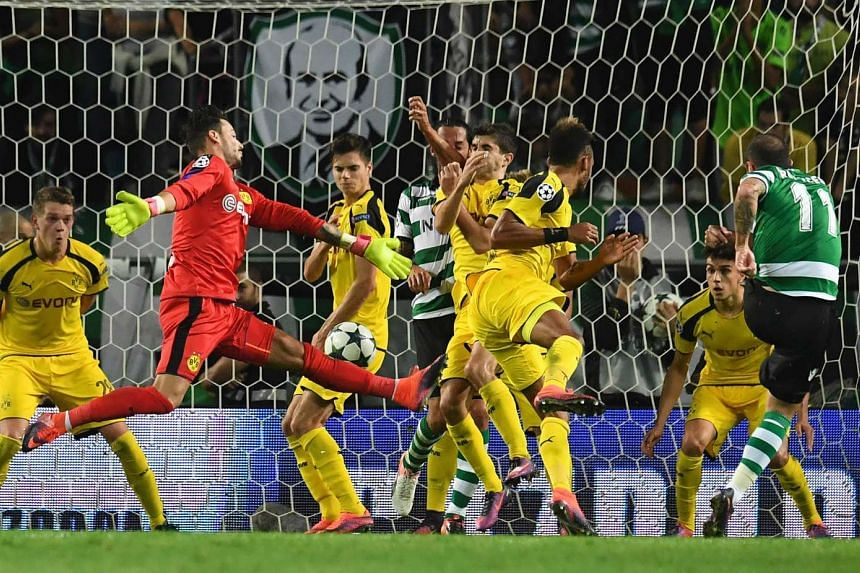 Sporting's Brazilian midfielder Bruno Cesar (right) kicks the ball to score a goal during the UEFA Champions League football match Sporting CP vs BVB Borussia Dortmund at the Jose Alvalade stadium in Lisbon on Oct 18, 2016.