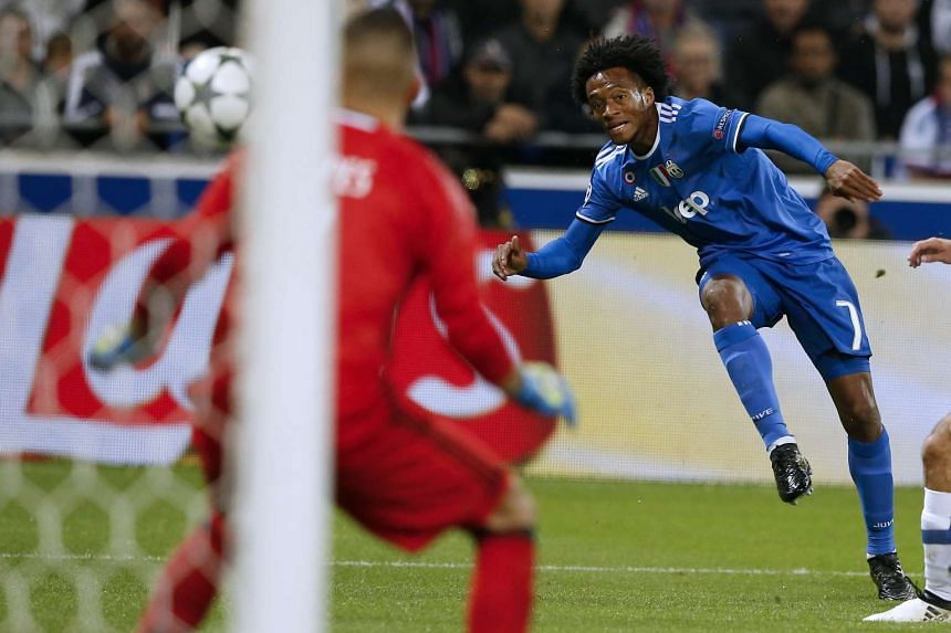 Juan Cuadrado of Juventus Turin scores the 1-0 lead during the UEFA Champions League group H soccer match between Olympique Lyon and Juventus Turin at Parc Olympique Lyonnais in Decines, near Lyon, France, on Oct 18, 2016.