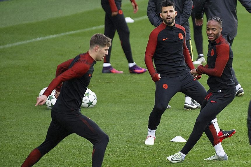 Manchester City's Sergio Aguero (centre) training with John Stones (left) and Raheem Sterling (right) ahead of their Champions League clash against Barcelona at the Nou Camp. Striker Aguero is hopeful Argentina team-mate Lionel Messi will have an off