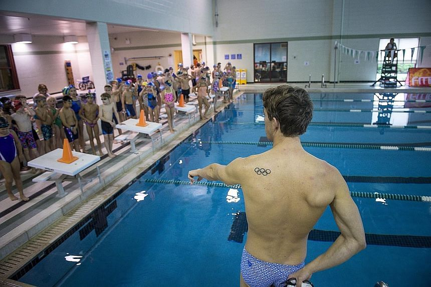 Above: Olympic silver medallist Connor Jaeger conducting a swimming clinic for kids in Media, Pennsylvania. Left: American Connor Jaeger on the podium after finishing second in the 1,500m freestyle final at the Rio Olympics in August.