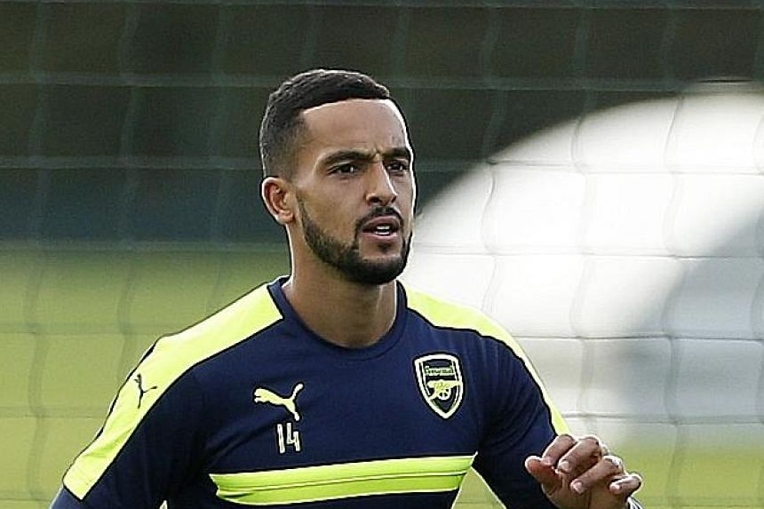 Theo Walcott training yesterday for Arsenal's Champions League clash against Bulgarian side Ludogorets. The resilient north London team are behind Premier League leaders Manchester City just on goal difference.