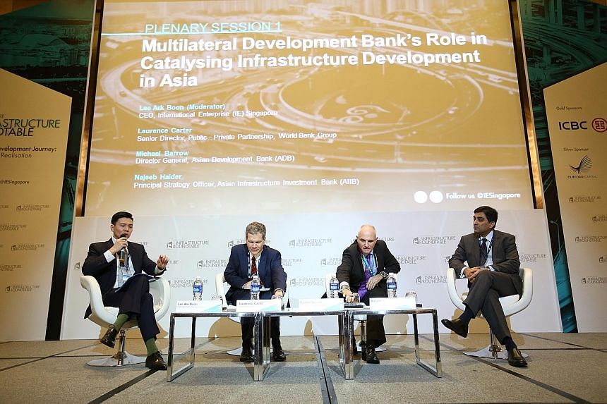At the panel discussion yesterday are (from left) IE Singapore CEO Lee Ark Boon, World Bank Group senior director Laurence Carter, ADB's Mr Barrow and Asian Infrastructure Investment Bank's Mr Haider.