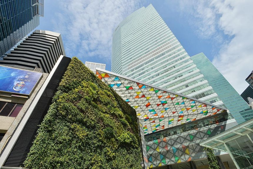 Higher income from Ocean Financial Centre (left, with green wall facade) and better results from its associates helped cushion the blow in the third quarter for Keppel Reit.