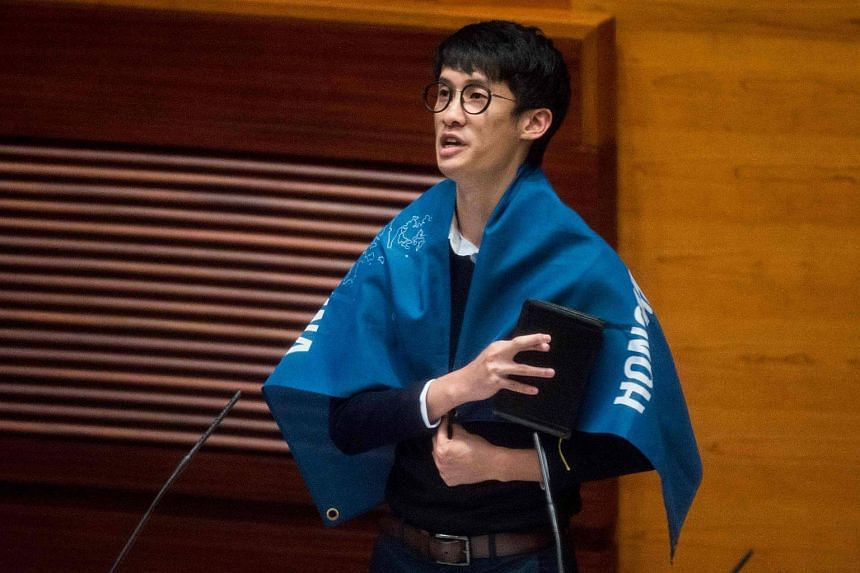 "Newly elected lawmaker Baggio Leung wears a flag reading ""Hong Kong is not China"" as he takes the Legislative Council Oath at the first meeting of the Sixth Legislative Council (Legco) in Hong Kong on Oct 12, 2016."