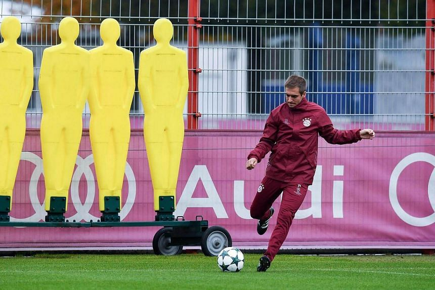 Bayern Munich's Philipp Lahm kicks a ball during a training session of the team in Munich, Germany on Oct 18, 2016.