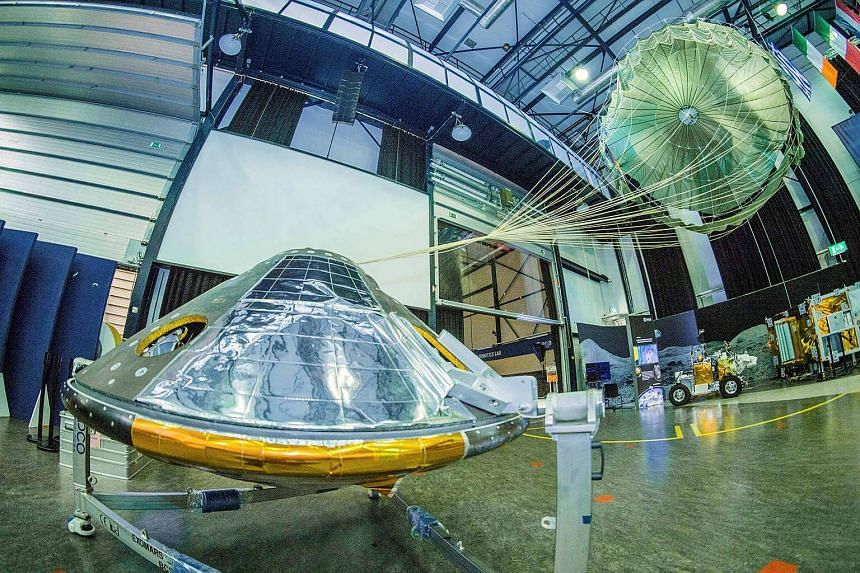 A full-size model of the European ExoMars entry, descent and landing module, Schiaparelli, with its parachute deployed.