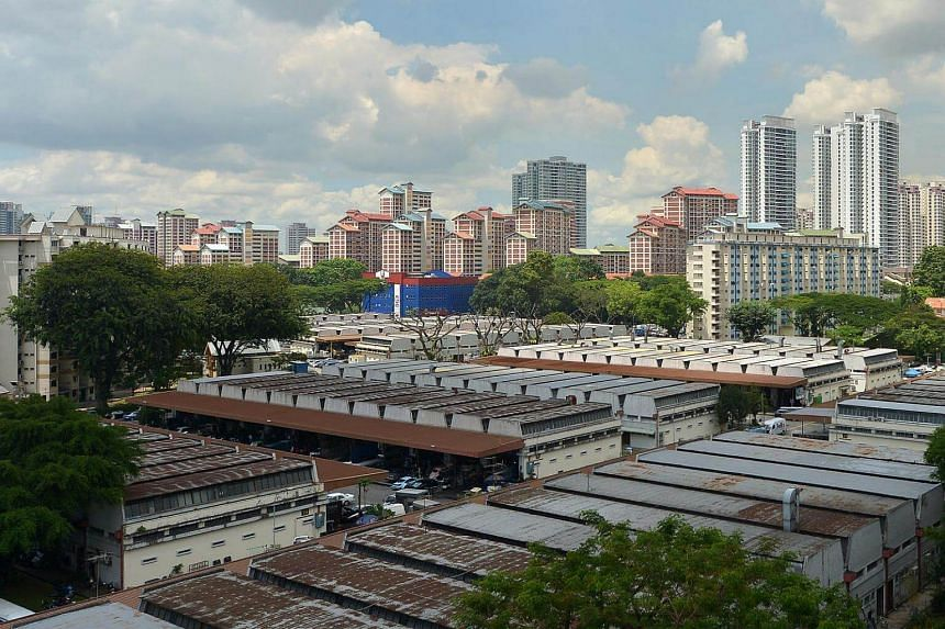 A view of the high rise HDB flats in the Bishan estate (background) and motor workshops at Sin Ming industrial estate (foreground).