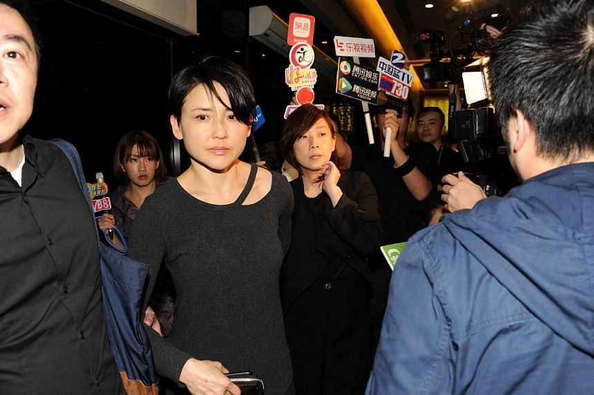 Prudence Liew (front) and Sandy Lam (back) at the wake.