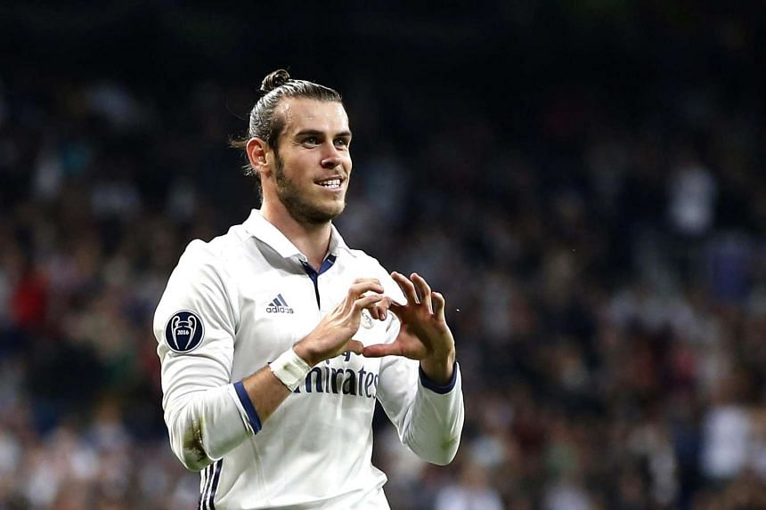 Real Madrid's Welsh midfielder Gareth Bale celebrates the first goal for the team.