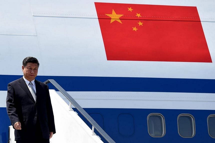 Chinese President Xi Jinping gestures on his arrival at the airport in Goa on Oct 15, 2016.