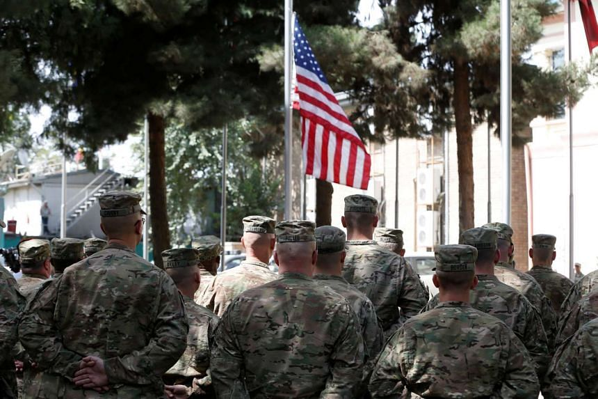 US soldiers mark the 15th anniversary of the 9/11 attacks, in Kabul, Afghanistan Sept 11, 2016