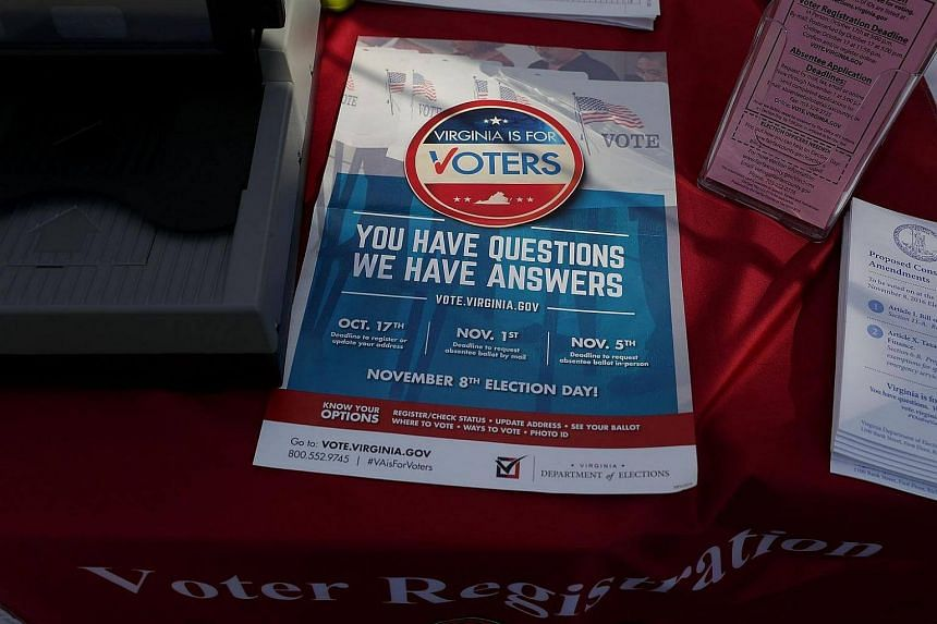 A flyer regarding voting deadlines is seen at the booth of Fairfax County Office of Elections during the annual Korus festival, a Korean cultural festival in Tysons Corner, Virginia.