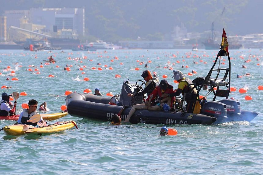 The female swimmer being pulled out of the water during the race.