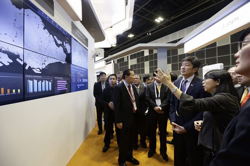 Senior Minister of State for Transport Ng Chee Meng touring the exhibition.