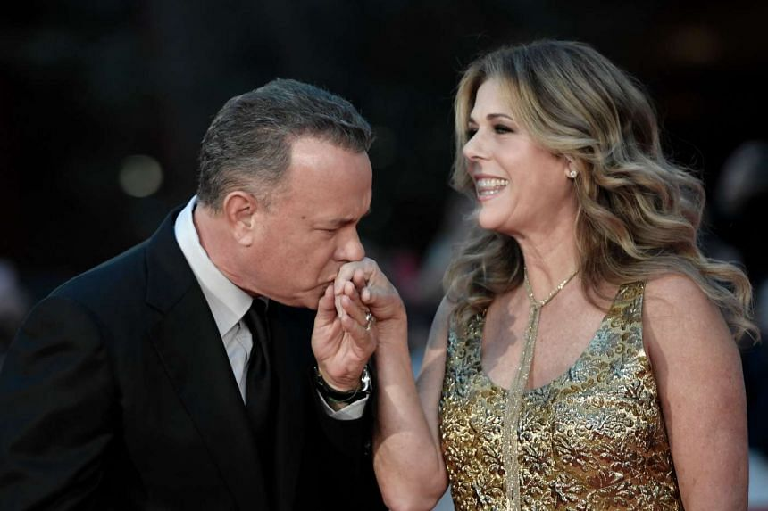 US Actor Tom Hanks arrives with his wife Rita Wilson at the Rome Film Festival on Oct 13, 2016.