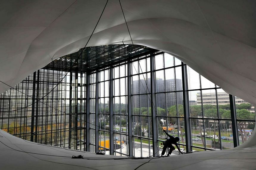 A man works on the structure of the new convention centre designed by Italian architect Massimiliano Fuksas.