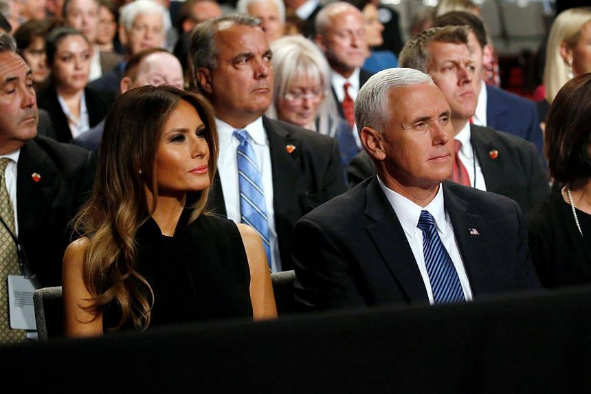 Melania Trump (left), wife of Donald Trump, and vice presidential nominee Mike Pence attend Trump's third and final 2016 presidential campaign debate.