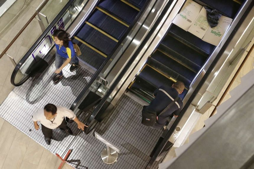 A small section of steps (right flight) were damaged at the base of an escalator situated between Starbucks and UNIQLO at Waterway Point on Oct 19, 2016.