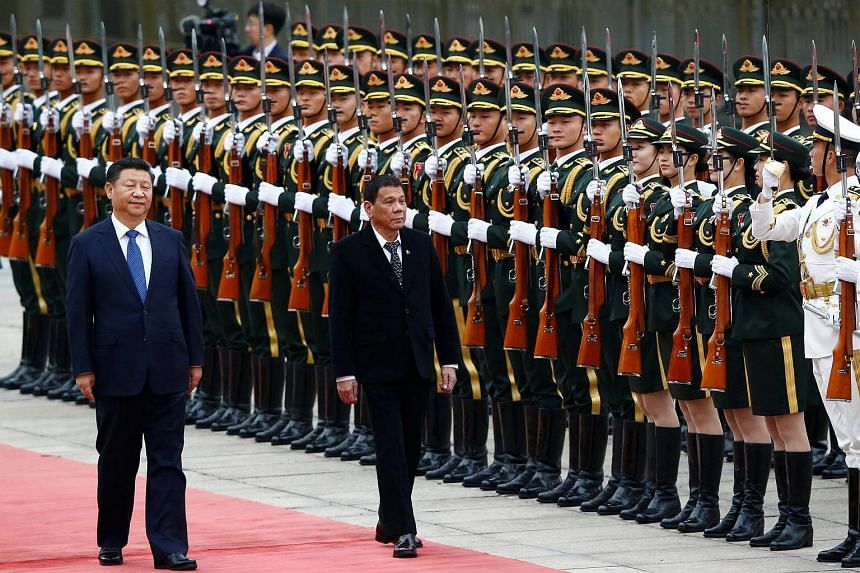 President of the Philippines Rodrigo Duterte and Chinese President Xi Jinping review the guard of honor as they attend a welcoming ceremony at the Great Hall of the People in Beijing.