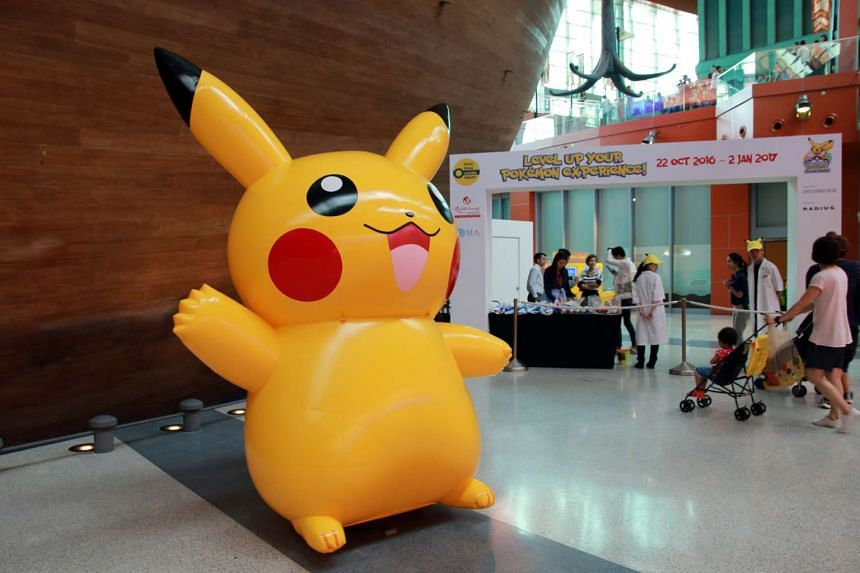 An inflated Pikachu greets visitors at the entrance of the Pokemon Research Exhibition at S.E.A Aquarium in Resorts World Sentosa.