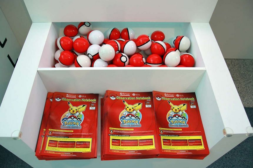 Pokeballs and observation notebooks on display at the opening of the Pokemon Research Exhibition at S.E.A Aquarium in Resorts World Sentosa on Oct 20, 2016.