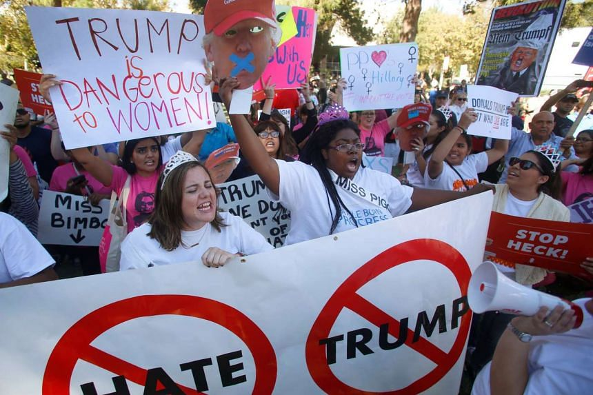 Protesters gather during demonstrations on the campus of University of Nevada, Las Vegas, before the last 2016 US presidential debate in Las Vegas, Nevada on Oct 19, 2016.