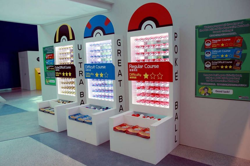 Pokeballs and observation notebooks, sorted by course difficulty, on display at the opening of the Pokemon Research Exhibition at S.E.A Aquarium in Resorts World Sentosa on Oct 20, 2016.