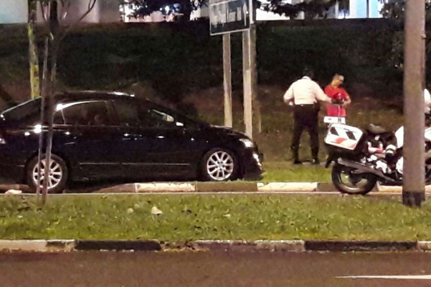 A black car rammed into a road sign after attempting to evade a police road block on Xilin Ave on Oct 20, 2016.