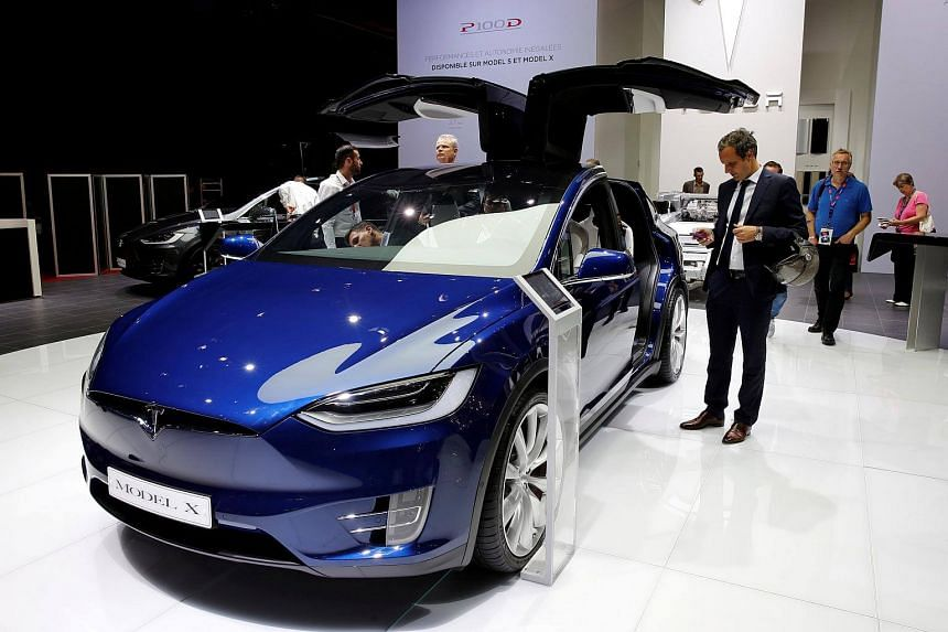 The Tesla Model X car is displayed on media day at the Paris auto show.