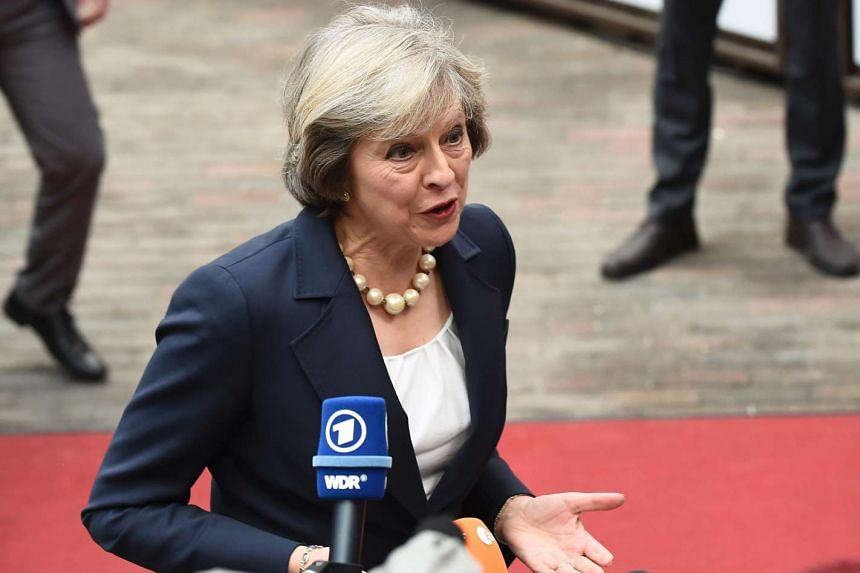 Britain's Prime minister Theresa May addresses journalists as she arrives for an European Union leaders summit on Oct 20, 2016 at the European Council in Brussels.