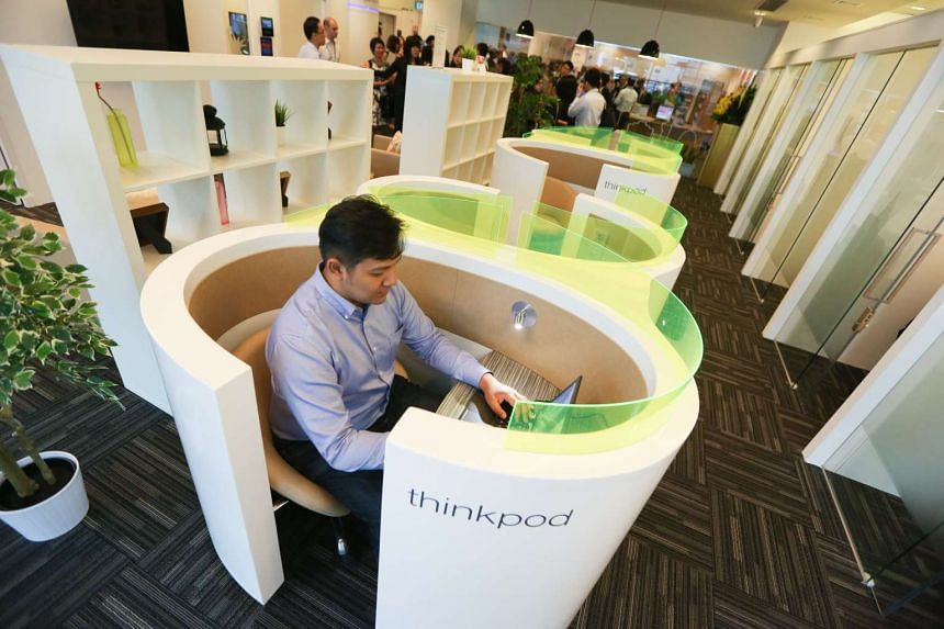 A person making use of a thinkpod at a Smart Work Centre (SWC) at Jurong Regional Library, where they were launched on May 20, 2014.