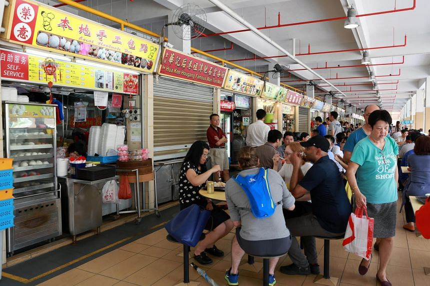 People having lunch at Old Airport Road Food Centre.