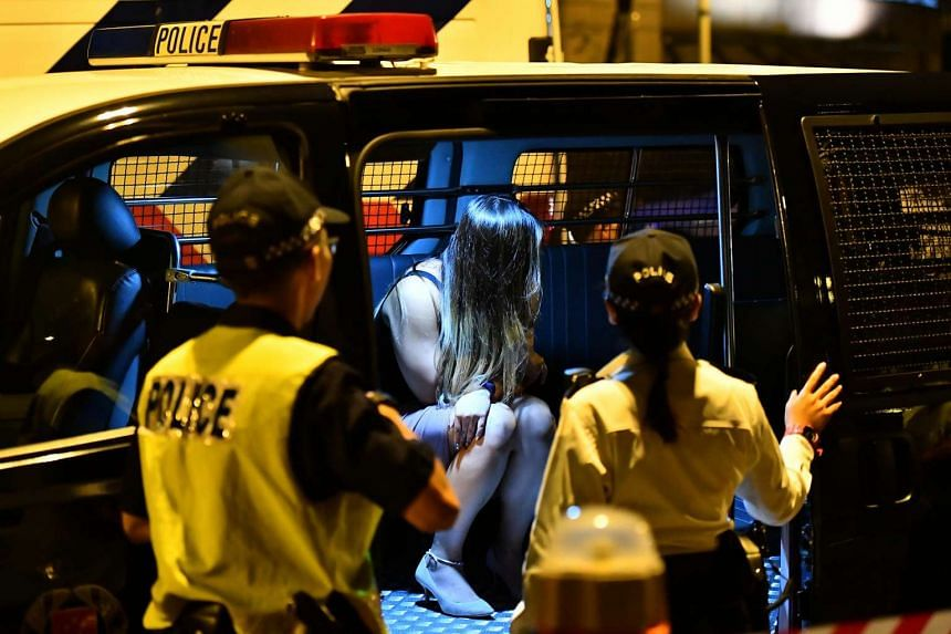 A driver suspected of drink-driving inside the police van on Oct 20, 2016.