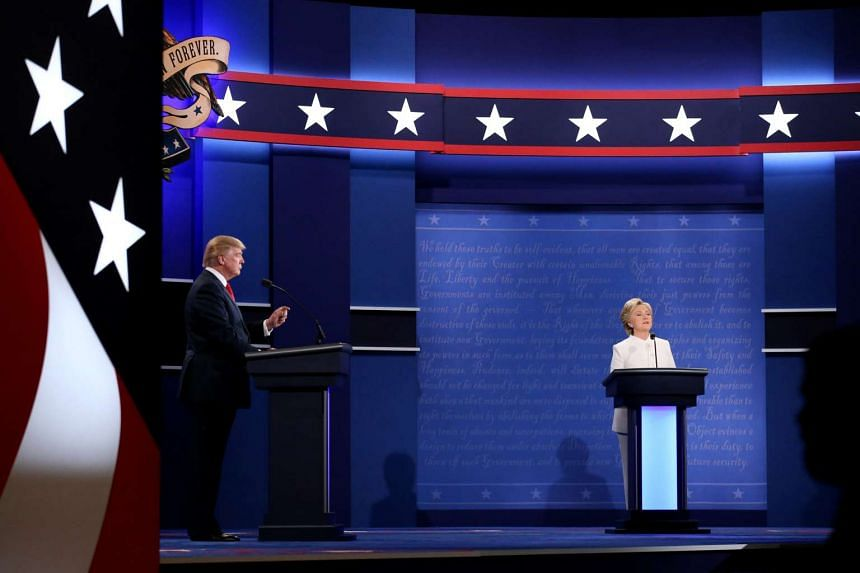 Republican US presidential nominee Donald Trump (left) speaks as Democratic US presidential nominee Hillary Clinton listens during their third and final 2016 presidential campaign debate.
