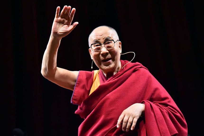 Tibetan spiritual leader and Nobel laureate Dalai Lama gestures during a ceremony at which he was made an honorary citizen of the Italian city of Milan on Oct 20, 2016 at Arcinboldi Thetare in Milan.
