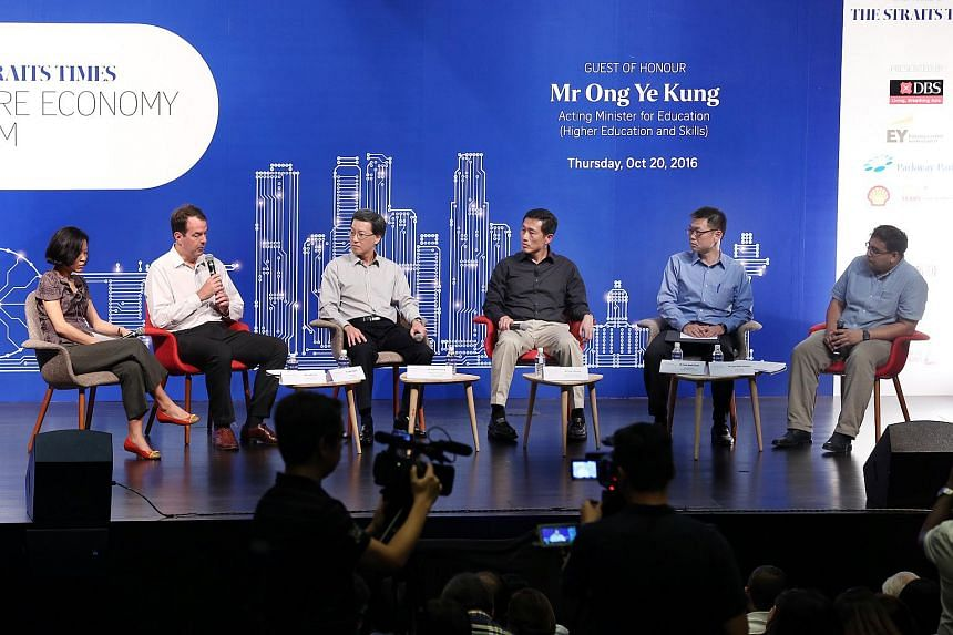 (From left) Ms Lydia Lim, Dr John Powers, Mr Andrew Chong, Minister Ong Ye Kung, Mr Yeoh Keat Chuan and Mr Syed Zakir Hussain during a panel on jobs of the future at the Straits Times Future Economy Forum on Oct 20, 2016.