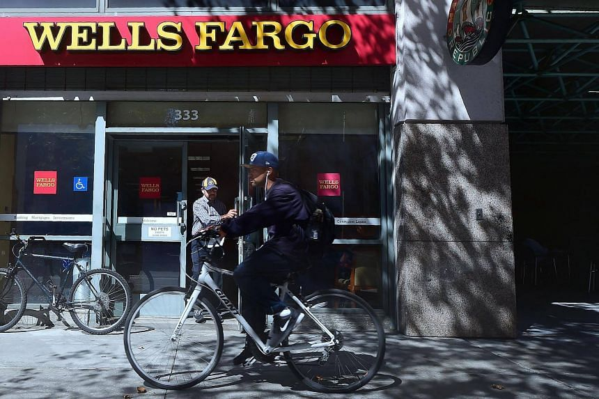 A man riding by a branch of Wells Fargo bank in Los Angeles on Oct 3, 2016.
