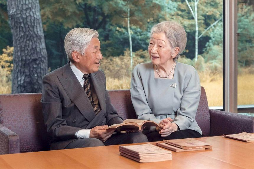Japan's Emperor Akihito and Empress Michiko read a book at the Imperial Palace in Tokyo on Sept 23, 2016.