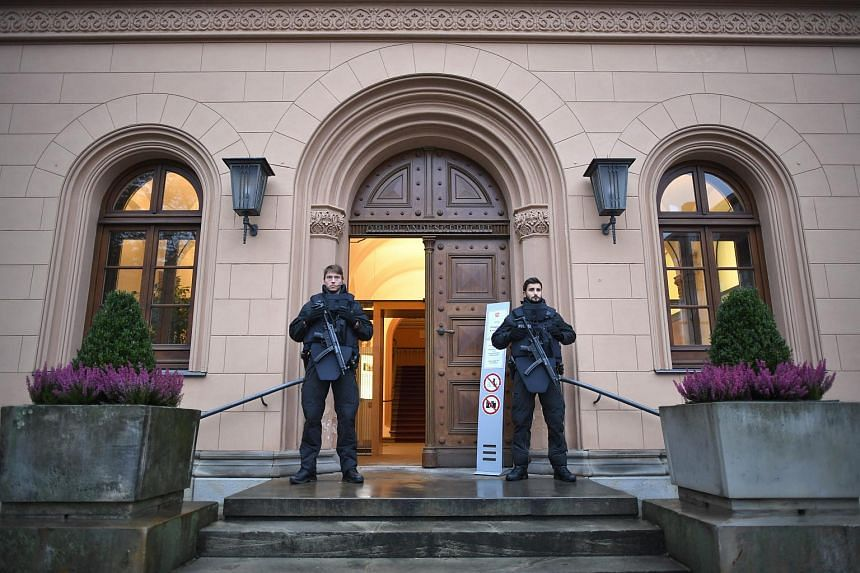 Police stand at the entrance of the Oberlandesgericht regional court during a hearing for 16-year-old Safia S. in Celle, Germany on Oct 20, 2016.